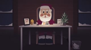 Papercut Santa sits at a desk ready to judge