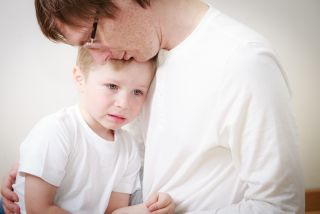 father comforting scared kid