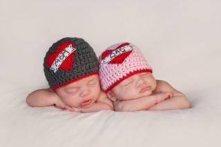 Five week old sleeping boy and girl fraternal twin newborn babies.