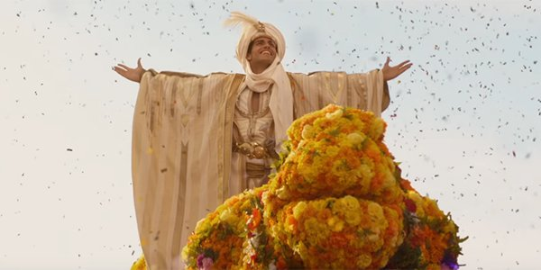 Prince Ali entering Agrabah in celebration in Aladdin