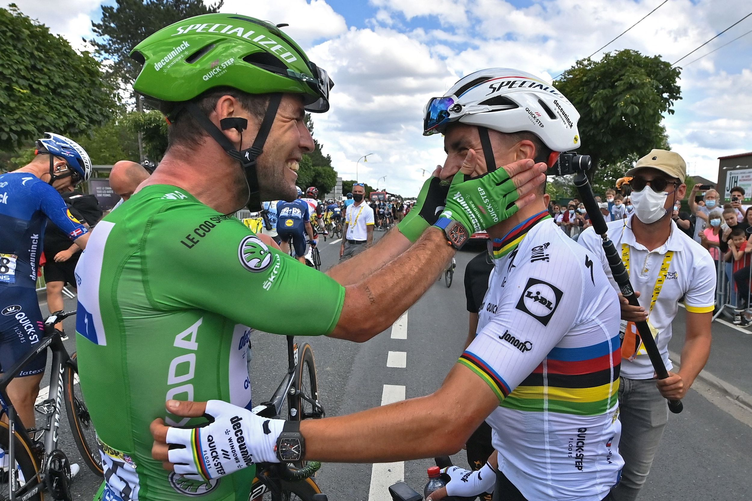 Mark Cavendish celebrates with Julian Alaphilippe after winning his second stage of the 2021 Tour de France