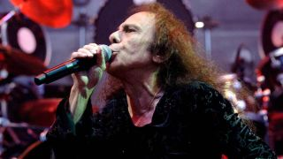 Ronnie James Dio singing into a microphone onstage