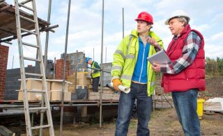 talking to builder on site