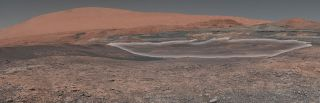 NASA's Mars rover Curiosity has surpassed its 2,000th day on Mars. To celebrate, NASA unveiled this new panorama from Curiosity showing the mound Mount Sharp (which the rover is climbing) and a region of clay materials (highlighted in white) that the rove