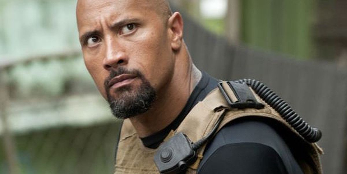 """Dwayne """"The Rock"""" Johnson staring off into the distance"""