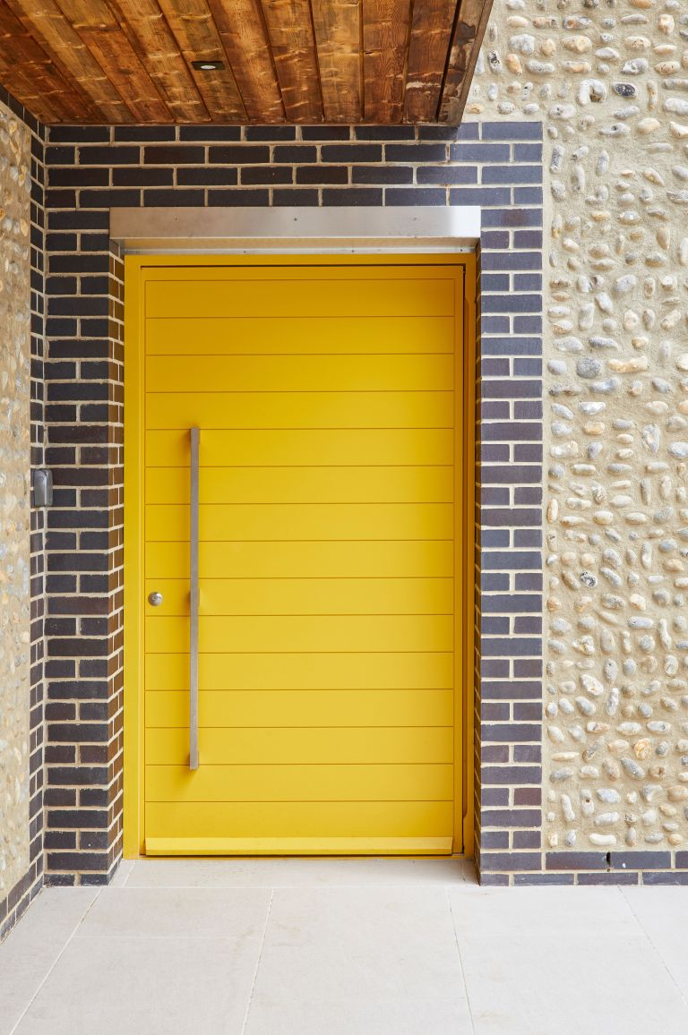 contemporary yellow front door from urban front
