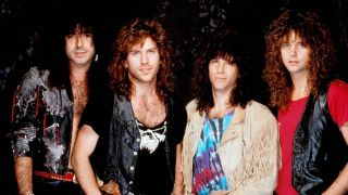 Line up shot of melodic rock band Winger with frontman Kip Winger second from the right