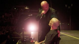 A picture of David Draiman and Disturbed fan Pete in Auckland