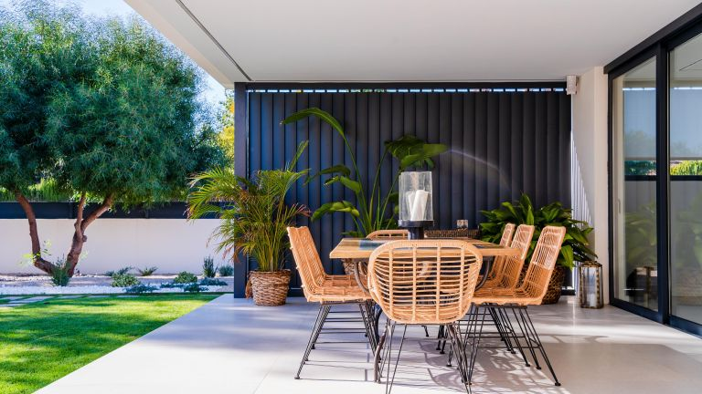 modern enclosed patio ideas with table and chairs