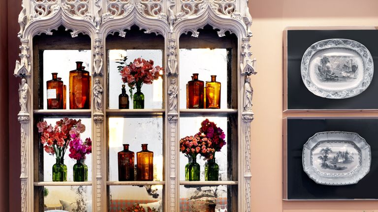 Glass cabinet and pink paint in The Orangery by Firmdale Hotels, designed by Kit Kemp