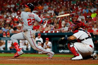 ST LOUIS, MO - SEPTEMBER 17: Juan Soto #22 of the Washington Nationals hits an RBI sacrifice fly against the St. Louis Cardinals in the ninth inning at Busch Stadium on September 17, 2019 in St Louis, Missouri.