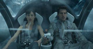 Olg Kurylenko and Tom Cruise take to the skies