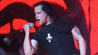 Glenn Danzig singing into a mic onstage