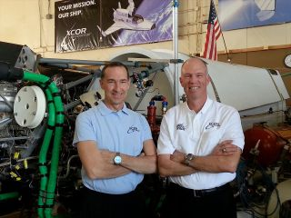 Rick Searfoss, XCOR chief test pilot (at right), with SpaceShipOne and XCOR test pilot Brian Binnie in XCOR's hangar in 2014.