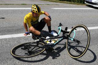 Primoz Roglic gets up after his crash while leading GC in Critérium du Dauphiné