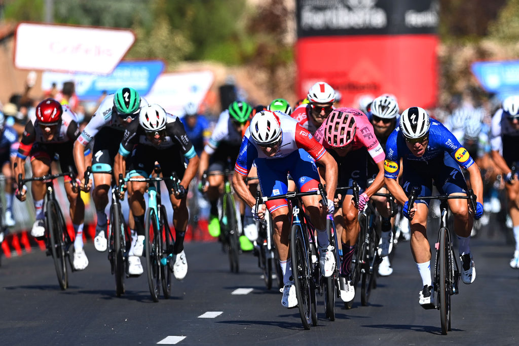MOLINA DE ARAGON SPAIN AUGUST 17 Fabio Jakobsen of Netherlands and Team Deceuninck QuickStep sprints to win ahead of Arnaud Demare of France and Team Groupama FDJ and Magnus Cort Nielsen of Denmark and Team EF Education Nippo during the 76th Tour of Spain 2021 Stage 4 a 1639km stage from El Burgo de Osma to Molina de Aragn 1134m lavuelta LaVuelta21 on August 17 2021 in Molina de Aragn Spain Photo by Stuart FranklinGetty Images