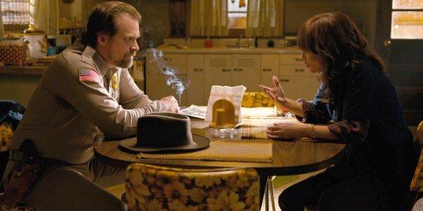 Stranger Things 3 Hopper smokes as Joyce tells him a story at the kitchen table