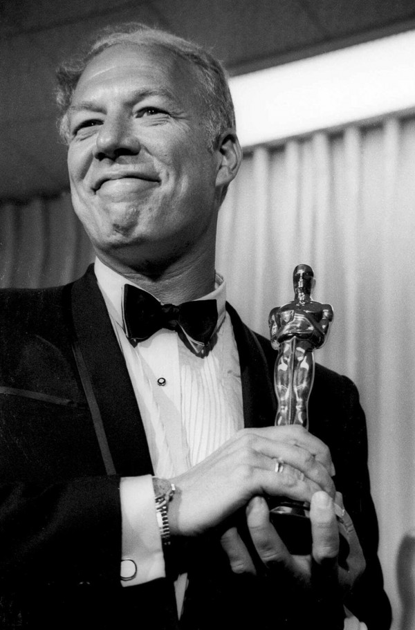 George Kennedy holding his Oscar