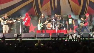 A picture of Dave Grohl on stage with Prophets Of Rage