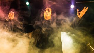 A photograph of Jaz Coleman on stage
