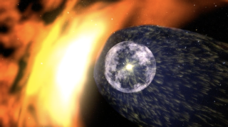 """This illustration shows our solar system suspended in the """"bubble"""" of protective solar wind known as the heliosphere. Where the sphere ends, harsh cosmic rays butt up against our solar system."""