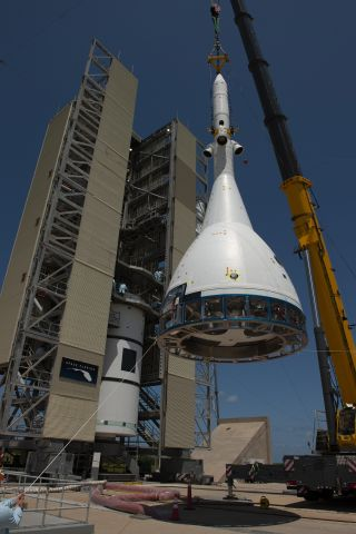 A test version of NASA's Orion crew module for Ascent Abort-2, with its launch abort system attached, is hoisted by crane at Space Launch Complex 46 at Cape Canaveral Air Force Station in Florida on May 23, 2019.