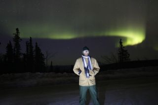 SPACE.com reporter MIke Wall with Alaska's northern lights