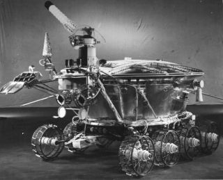 On November 17, 1970 the Soviet Luna 17 spacecraft landed the first roving remote-controlled robot on the Moon. Known as Lunokhod 1, it weighed just under 2,000 pounds and was designed to operate for 90 days while guided by a 5-person team on planet Earth
