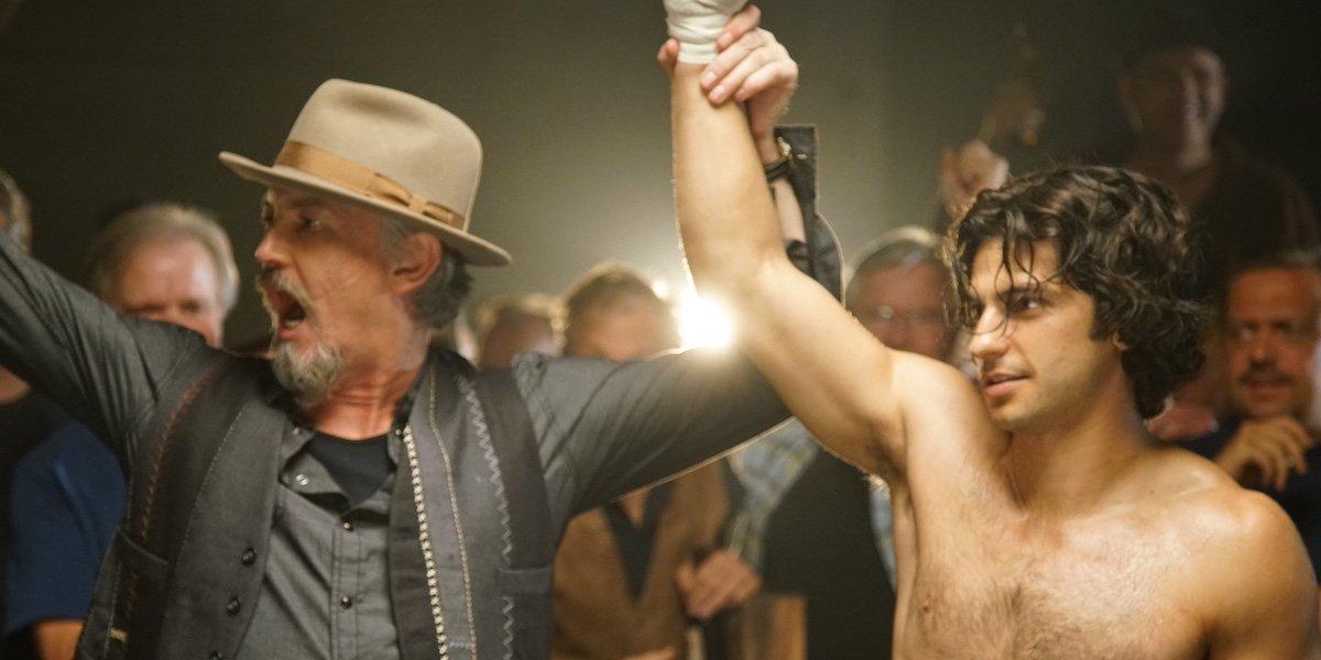 Sean Patrick Flanery holding George Kosturos' arm up, declaring him winner of fight