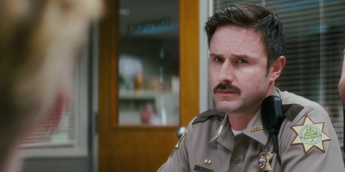 Scream 4 David Arquette looking skeptical in the office