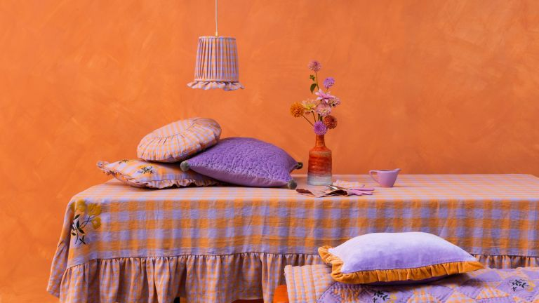 Table skirt in an orange painted room with soft furnishings