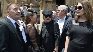 The estranged members of AC/DC bonded anew at former band leader Malcolm Young's funeral in Sydney in 2017