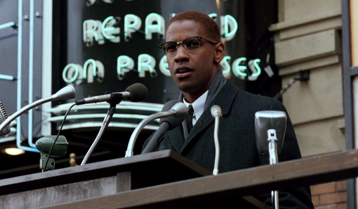 Malcolm X giving a speech outdoors