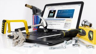 A laptop covered in tools and equipment