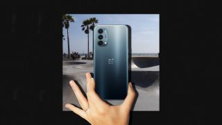 OnePlus Nord N200 5G with a skate park and beach behind it