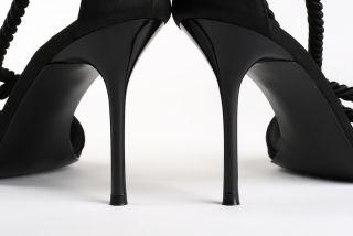 High heeled black stilettos