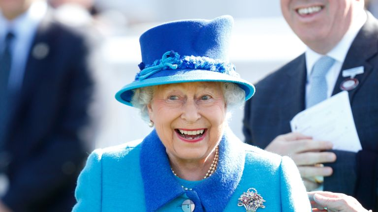 Queen Elizabeth II, who celebrated her 91st birthday yesterday, watches her horse 'Call To Mind' win The Dubai Duty Free Tennis Championships Maiden Stakes at the Dubai Duty Free Spring Trials Meeting at Newbury Racecourse on April 22, 2017 in Newbury, England