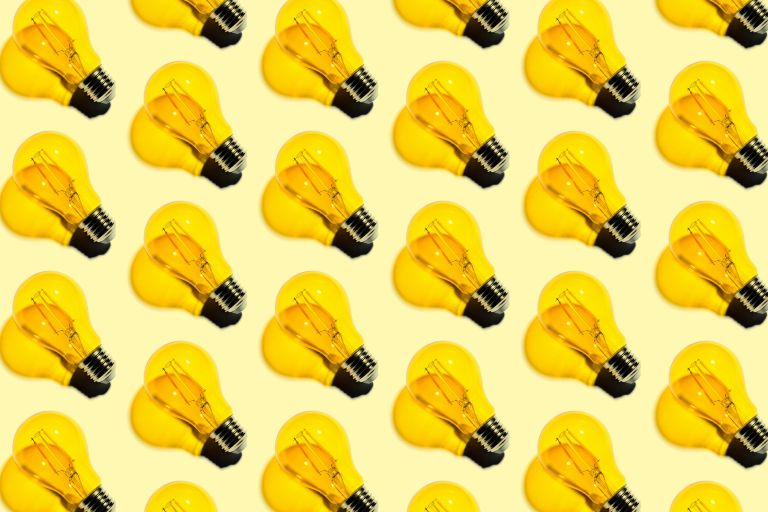 lots of yellow lightbulbs in a row on a yellow background