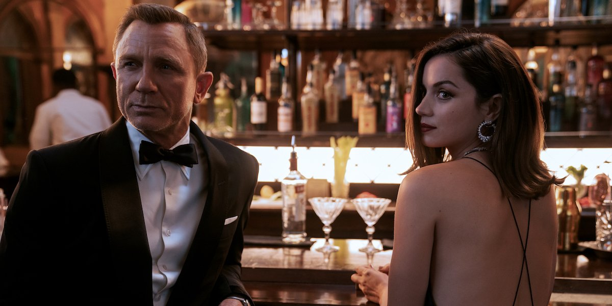 Daniel Craig and Ana de Armas as James Bond and Paloma at a bar in No Time To Die