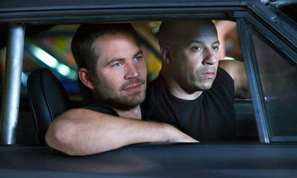 Paul Walker and Vin Diesel in Fast and Furious car