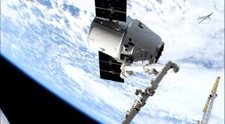An uncrewed SpaceX Dragon cargo ship makes its second trip to the International Space Station for NASA on the CRS-17 mission in this view captured during rendezvous operations on May 6, 2019.