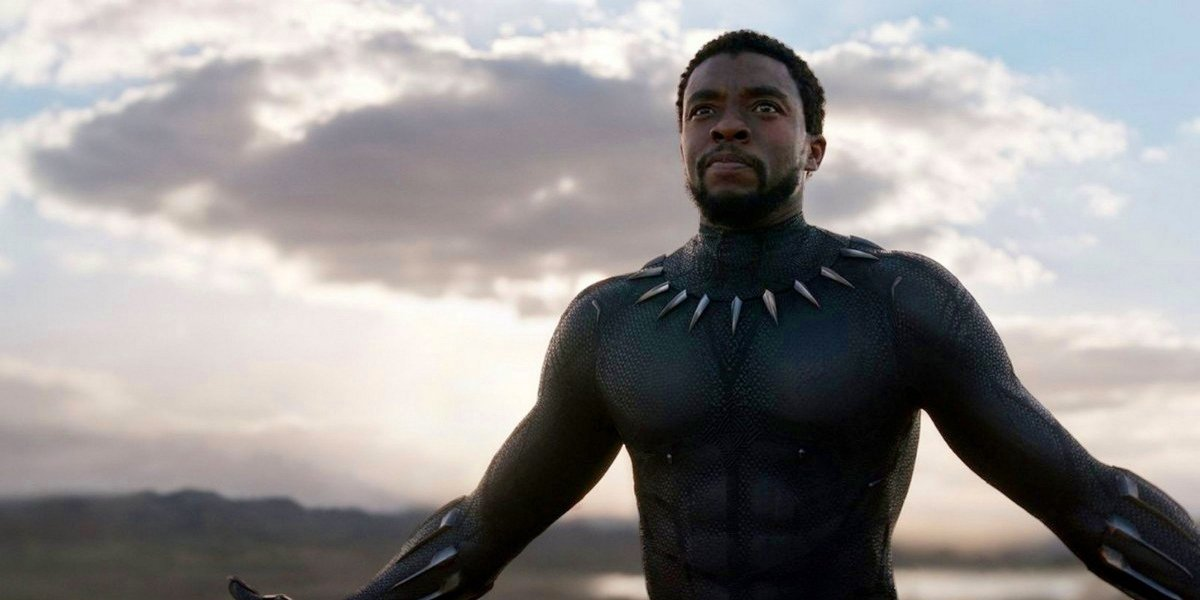 Black Panther Chadwick Boseman with arms wide open, in Wakanda