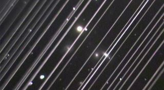 An image released by the IAU June 3 shows trails made by dozens of Starlink satellites as they passed through the field of view of a telescope during an observation shortly after launch. The IAU noted in its statement that the density and brightness of the satellites in this image is not representative of their appearance in their final orbital configuration.