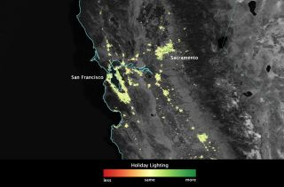 Image, created using data from the NOAA-NASA Suomi NPP satellite, showing how lights across San Francisco Bay Area shine more brightly in December than they do during the rest of the year.