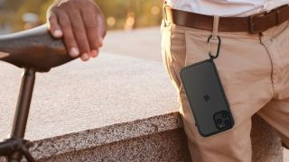 Catalyst Influence iPhone 12 Pro Max case attached to a man's belt