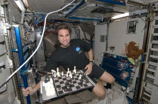 Checkmate: Astronaut Battles Earth in Chess