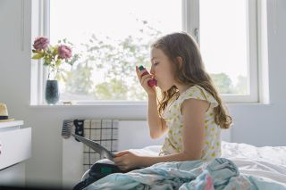 Are dehumidifiers good for asthma? Young girl using inhaler