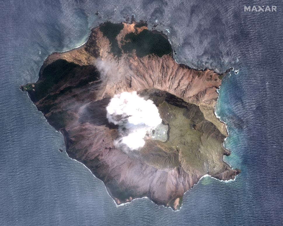A satellite image of New Zealand's White Island on Dec. 11, 2019, three days after the volcano erupted.