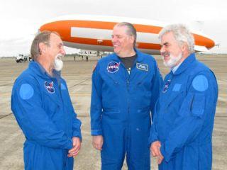 NASA researchers wait to board a zeppelin for a meteorite hunt