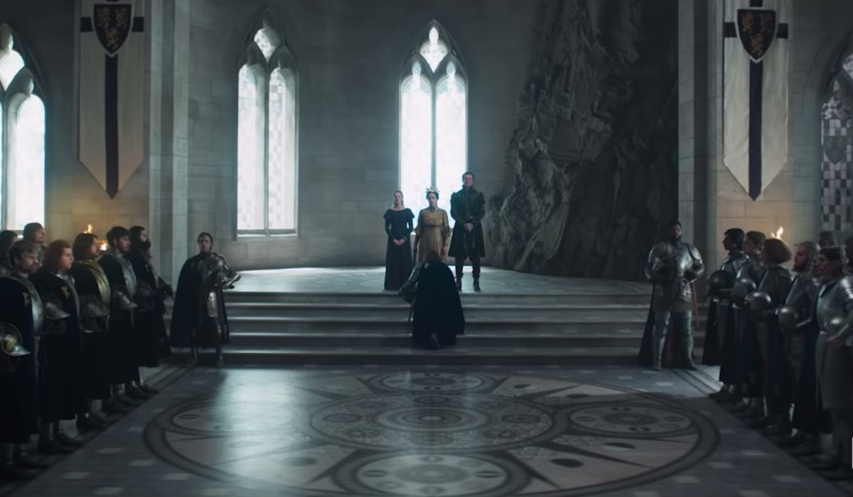 The Witcher a scene with a full royal court, and someone bowing to the royals